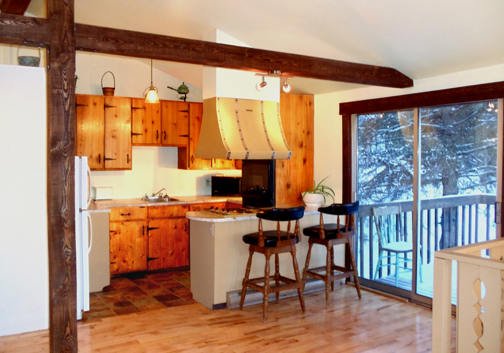 cottages rentals open concept kitchen with rustic pine cabinets