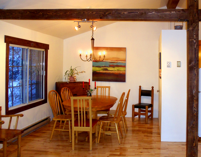 chalets rentals open concept dining room with hardwood floor and view of the fireplace