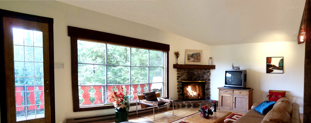 Chalet rental Very bright Living room with stone fireplace, lake and mountain view